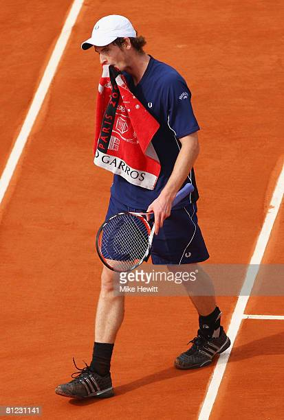 Andy Murray of Great Britain feels the pressure during the Men's Singles first round match against Jonathan Eysseric of France on day one of the...