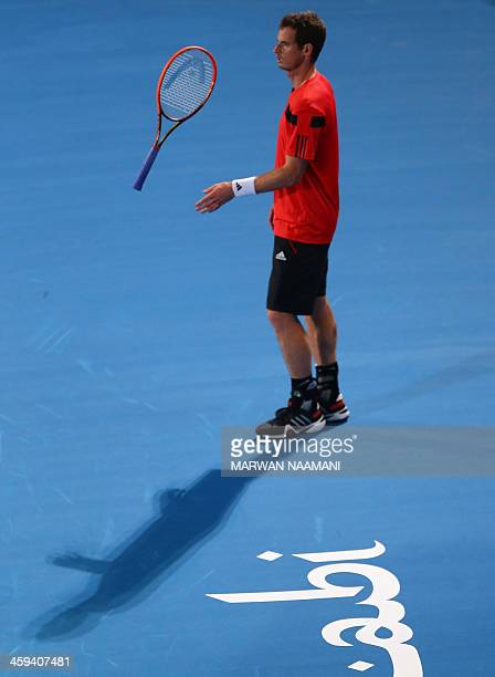 Andy Murray of Great Britain flips his racket after losing a point against France's JoWilfried Tsonga during their Mubadala World Tennis Championship...