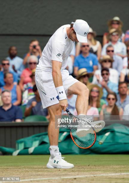 Andy Murray of Great Britain frustrated during his defeat by Sam Querrey of United States in their MenÄôs Singles Quarter Final Match at Wimbledon on...
