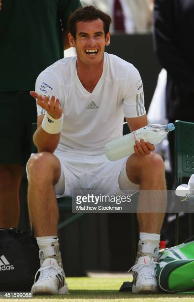 Andy Murray of Great Britain gestures during his Gentlemen's Singles quarterfinal match against Grigor Dimitrov of Bulgaria on day nine of the...
