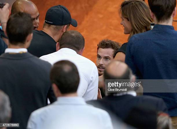 Andy Murray of Great Britain goes over to his players box to celebrate with his team after his straight sets victory against Rafael Nadal of Spain in...