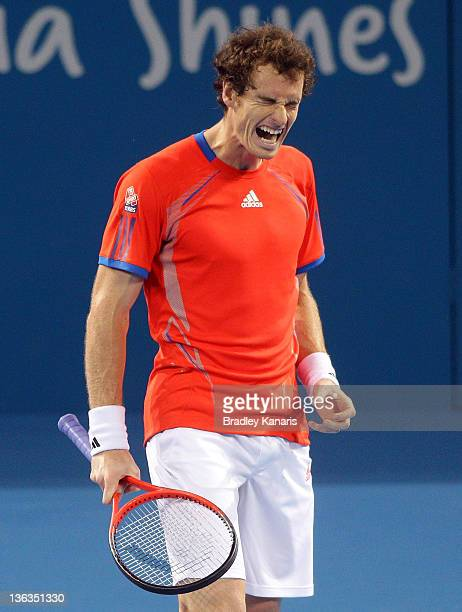 Andy Murray of Great Britain grimmaces in pain as he suffers from an injury in his match against Mikhail Kukushkin of Kazakhstan during day three of...