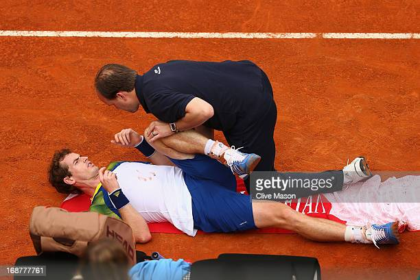 Andy Murray of Great Britain has treatment shortly before retiring from his second round match against Marcel Granollers of Spain on day four of the...