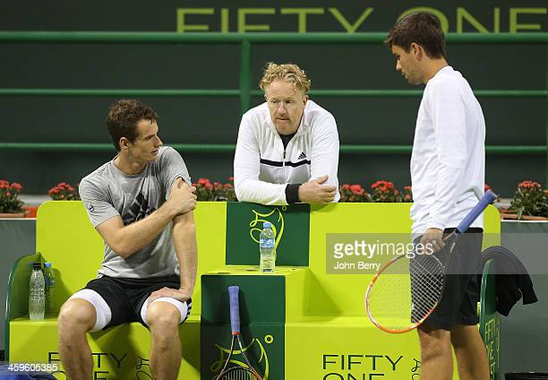 Andy Murray of Great Britain here with sparring partner Daniel Vallverdu practices prior to the Qatar ExxonMobil Open 2014 held at the Khalifa...