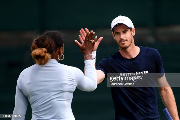 Andy Murray of Great Britain high fives mixed doubles partner Serena Williams of The United States at a practice session during Day five of The...