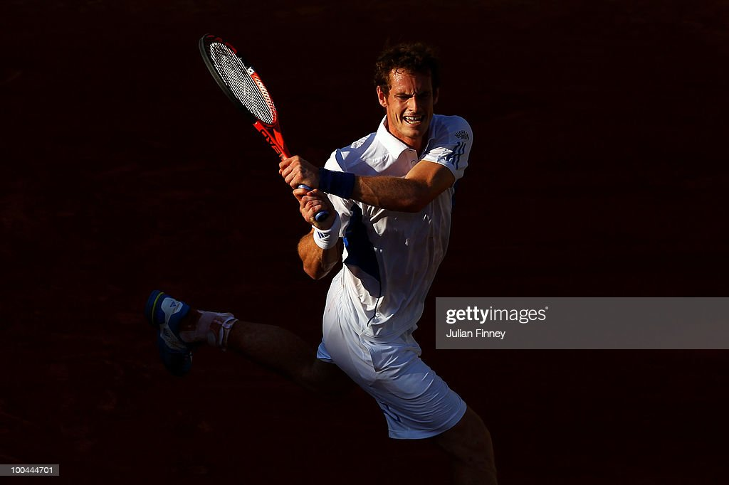 Andy Murray of Great Britain hits a backhand during the men's singles first round match between Andy Murray of Great Britain and Richard Gasquet of France on day two of the French Open at Roland Garros on May 24, 2010 in Paris, France.