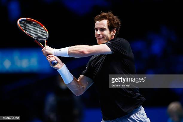 Andy Murray of Great Britain hits a backhand during the men's singles match against Stan Wawrinka of Switzerland on day six of the Barclays ATP World...