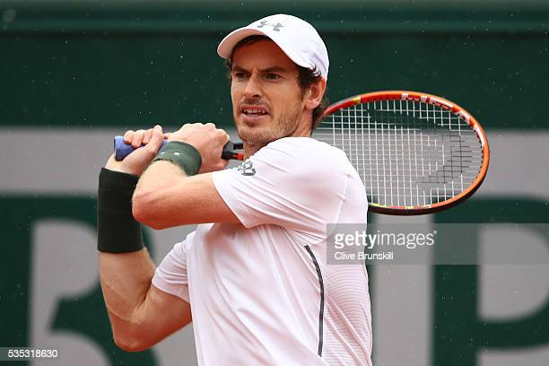 Andy Murray of Great Britain hits a backhand during the Men's Singles fourth round match against John Isner of the United States on day eight of the...