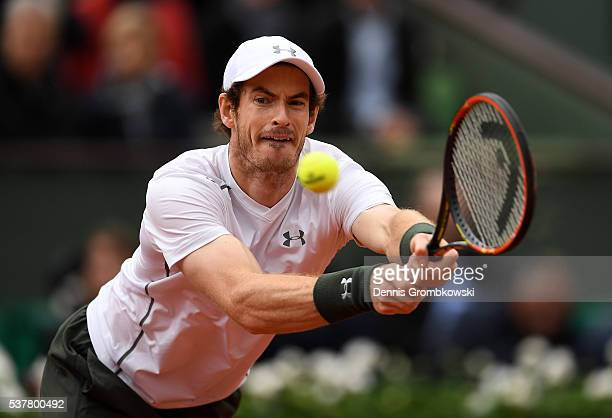 Andy Murray of Great Britain hits a backhand during the Men's Singles semi final match against Stan Wawrinka of Switzerland on day thirteen of the...