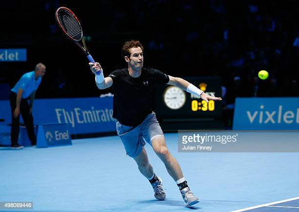 Andy Murray of Great Britain hits a forehand a forehand during the men's singles match against Stan Wawrinka of Switzerland on day six of the...