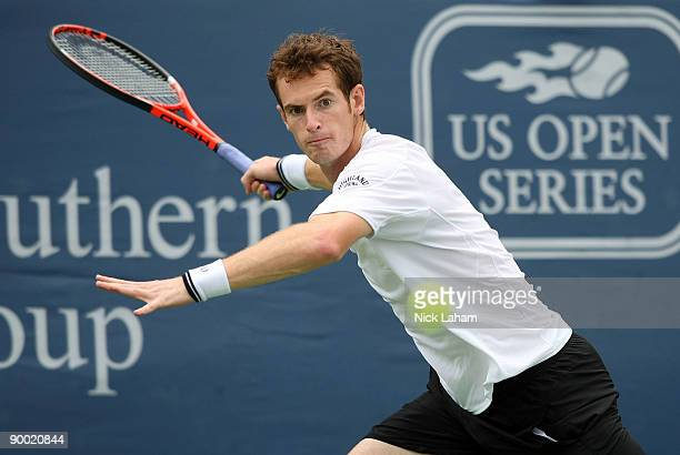 Andy Murray of Great Britain hits a forehand against Roger Federer of Switzerland during day six of the Western Southern Financial Group Masters on...