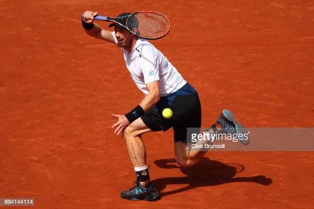 Andy Murray of Great Britain hits a forehand during the men's singles semi final match against Stan Wawrinka of Switzerland on day thirteen of the...