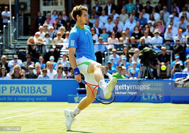 Andy Murray of Great Britain hits a game winning shot through his legs during his Men's Singles final against Jo-Wilfried Tsonga of France on day...