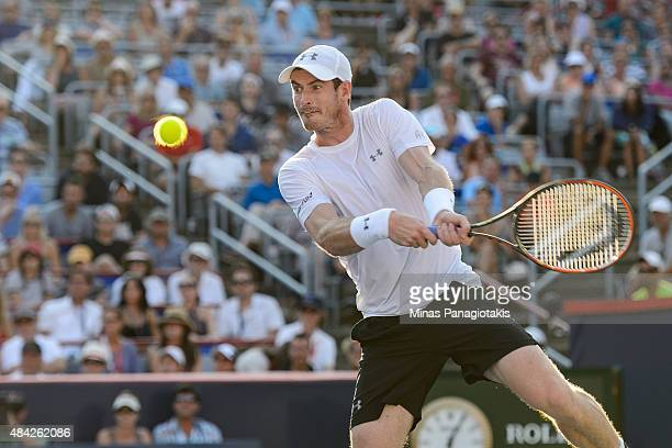 Andy Murray of Great Britain hits a return against Novak Djokovic of Serbia during day seven of the Rogers Cup at Uniprix Stadium on August 16, 2015...