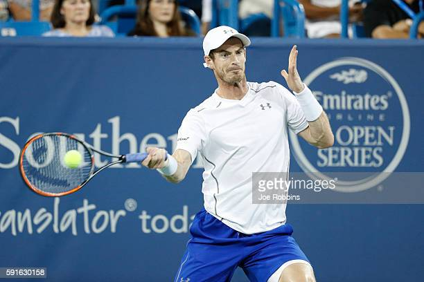 Andy Murray of Great Britain hits a return to Juan Monaco of Argentina on Day 5 of the Western Southern Open at the Lindner Family Tennis Center on...