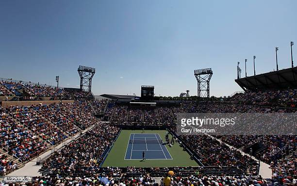 Andy Murray of Great Britain hits a return to Robin Haase of the Netherlands during his first round match at the Louis Armstrong stadium at the 2014...