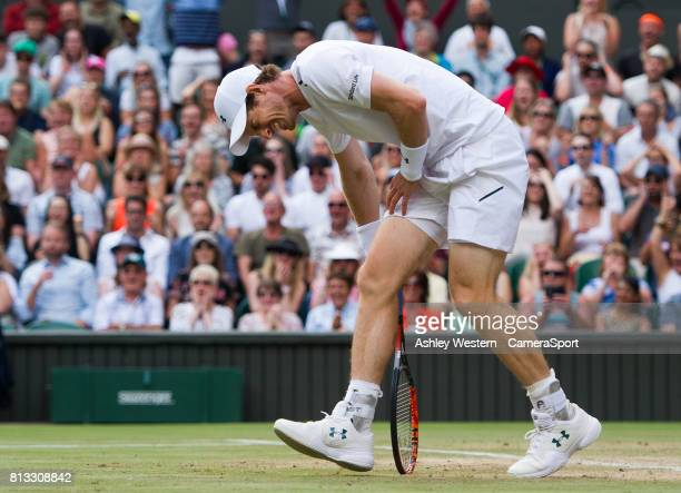 Andy Murray of Great Britain holding his hip during his defeat by Sam Querrey of United States in their Mens Singles Quarter Final Match at Wimbledon...
