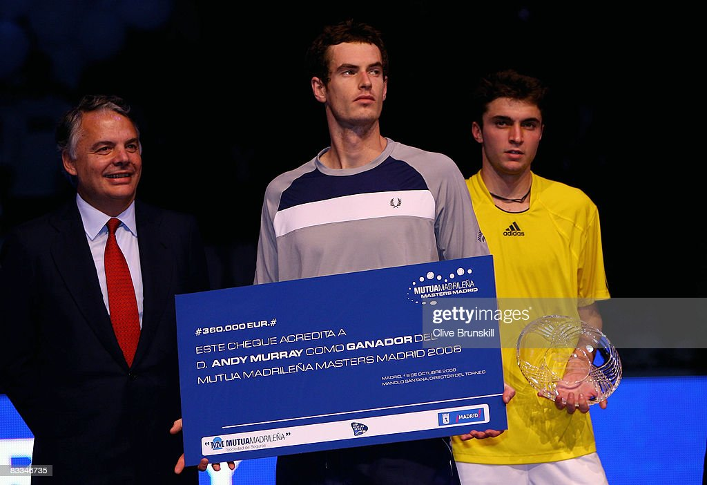 Andy Murray of Great Britain holds his winners cheque for 300,000 Euros after his straight sets victory against Gilles Simon of France during the final at the Madrid Masters tennis tournament at the Madrid Arena on October 19, 2008 in Madrid, Spain.