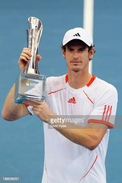 Andy Murray of Great Britain holds the Roy Emerson trophy after winning the Men's final match against Alexandr Dolgopolov of the Ukraine during day...
