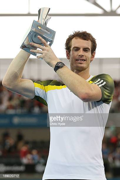 Andy Murray of Great Britain holds the winners trophy after his final match against Grigor Dimitrov of Bulgaria on day eight of the Brisbane...