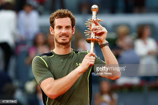 Andy Murray of Great Britain holds the winners trophy after his win over Rafael Nadal of Spain in the final during day nine of the Mutua Madrid Open...