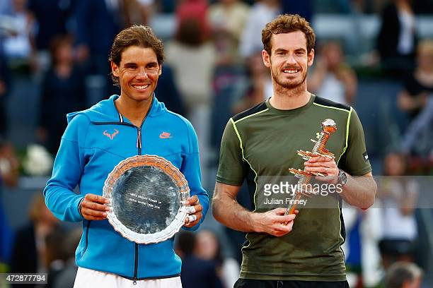 Andy Murray of Great Britain holds the winners trophy with runner up Rafael Nadal of Spain in the final during day nine of the Mutua Madrid Open...