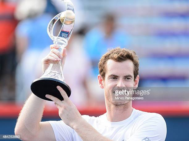 Andy Murray of Great Britain holds up the Rogers Cup after defeating Novak Djokovic of Serbia 64 46 63 during day seven of the Rogers Cup at Uniprix...