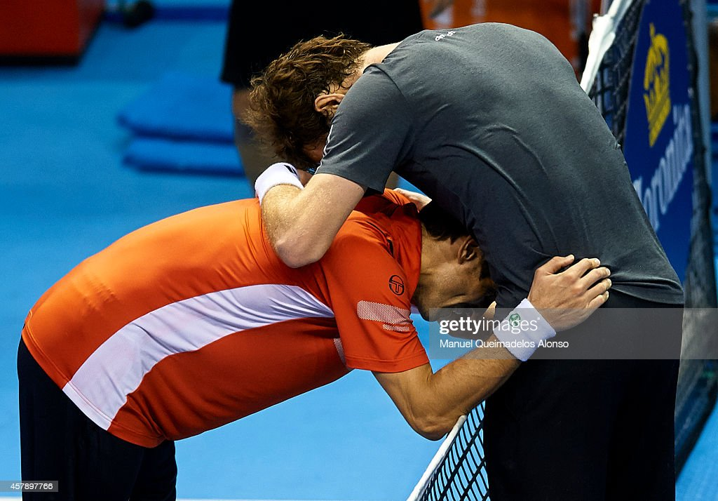 Andy Murray of Great Britain (R) hugs after his men's singles final match against Tommy Robredo of Spain during day seven of the ATP 500 World Tour Valencia Open tennis tournament at the Ciudad de las Artes y las Ciencias on October 26, 2014 in Valencia, Spain.