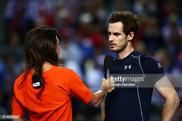 Andy Murray of Great Britain ia interviewed by Annabel Croft following victory during the singles match against Kei Nishikori of Japan on day three...