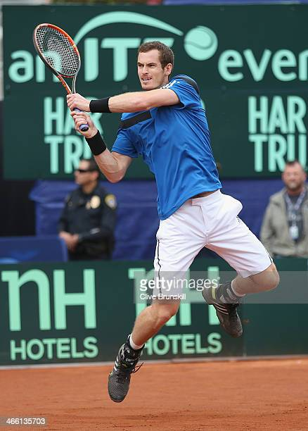 Andy Murray of Great Britain in action against Donald Young of the United States during day one of the Davis Cup World Group first round between the...