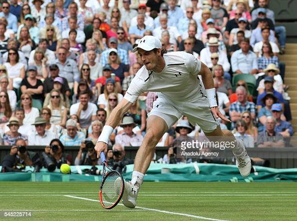 Andy Murray of Great Britain in action against JoWilfried Tsonga of France in the men's singles quarter finals on day nine of the 2016 Wimbledon...
