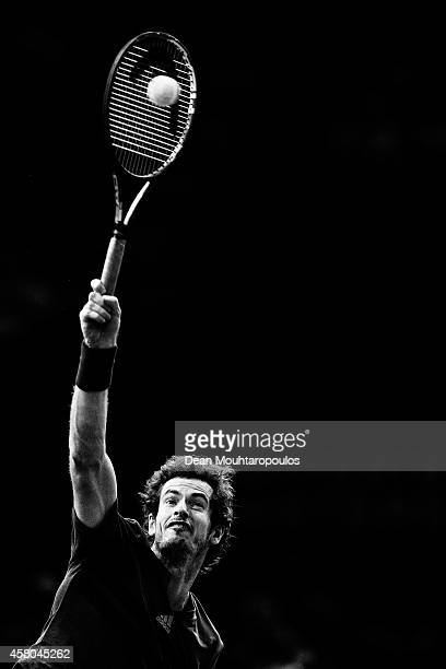 Andy Murray of Great Britain in action against Julien Benneteau of France during day 3 of the BNP Paribas Masters held at the at Palais Omnisports de...