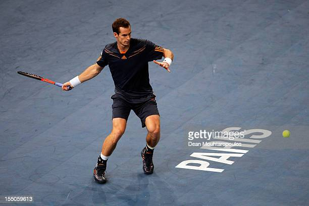 Andy Murray of Great Britain in action against Paul Henri Mathieu of France during day 3 of the BNP Paribas Masters at Palais Omnisports de Bercy on...