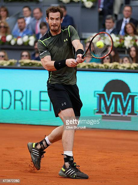 Andy Murray of Great Britain in action against Rafael Nadal of Spain in the mens final during day nine of the Mutua Madrid Open tennis tournament at...