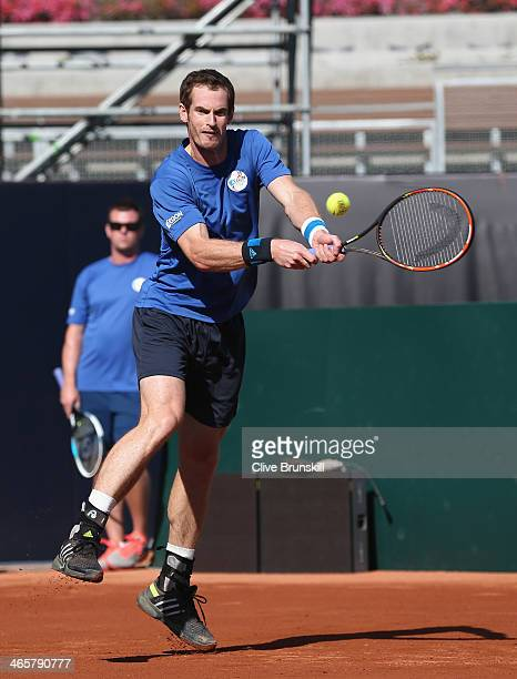 Andy Murray of Great Britain in action during a practice session watched by a Great Britain captain Leon Smith prior to the Davis Cup World Group...