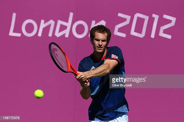 Andy Murray of Great Britain in action during a practice session ahead of the 2012 London Olympic Games at the All England Lawn Tennis and Croquet...