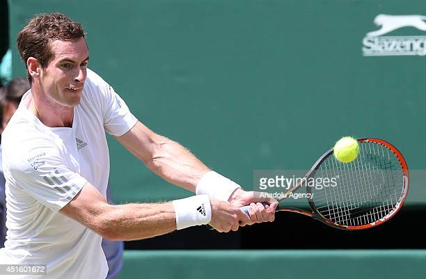 Andy Murray of Great Britain in action during his Gentlemen's Singles quarterfinal match against Grigor Dimitrov of Bulgaria on day nine of the...