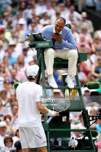 Andy Murray of Great Britain in discussion with chair umpire Mohamed Lahyani during the Gentlemen's Singles fourth round match against Benoit Paire...