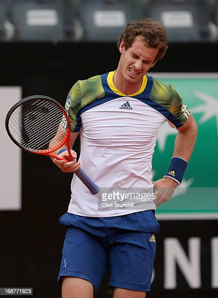 Andy Murray of Great Britain in pain against Marcel Granollers of Spain in their second round match during day four of the Internazionali BNL...
