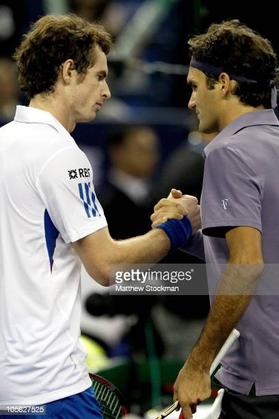 Andy Murray of Great Britain is congratulated at the net by Roger Federer of Switzerland after winning their match during the final on day seven of...