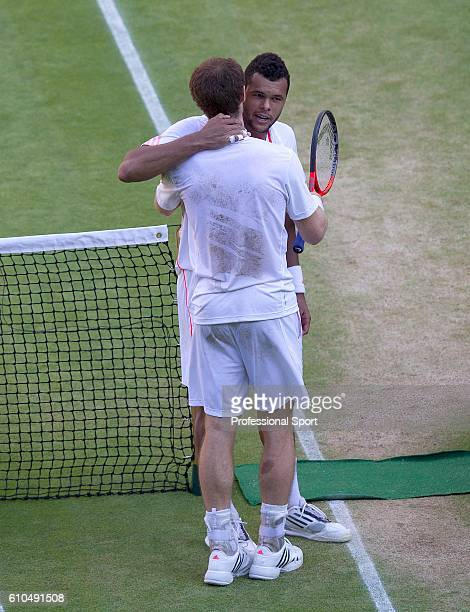 Andy Murray of Great Britain is congratulated by his opponent following his Gentlemen's Singles semifinal victory over JoWilfried Tsonga of France on...