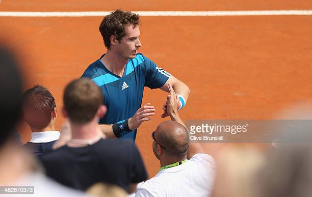Andy Murray of Great Britain is congratulated by his team mates after his straight sets victory over against Andreas Seppi of Italy in the second...