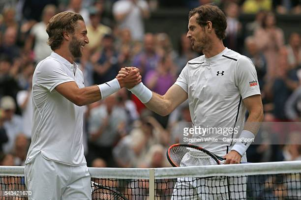 Andy Murray of Great Britain is congratulated by Liam Broady of Great Britain after his victory in their Gentlemen's Singles First Round match today...