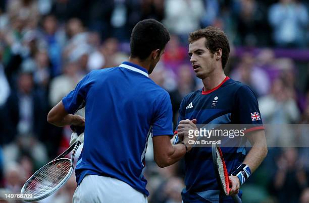 Andy Murray of Great Britain is congratulated by Novak Djokovic of Serbia after his 7-5, 7-5 win in the Semifinal of Men's Singles Tennis on Day 7 of...