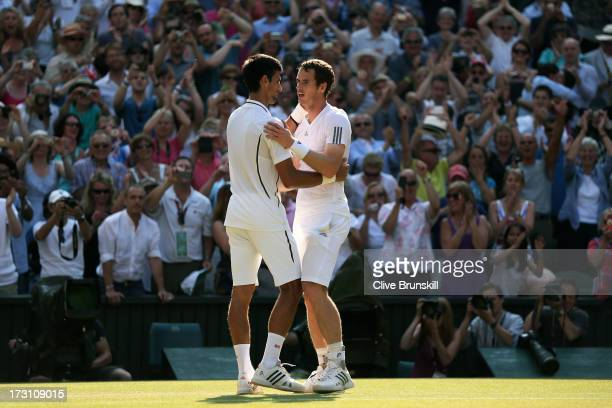 Andy Murray of Great Britain is congratulated by Novak Djokovic of Serbia following his victory in the Gentlemen's Singles Final match against Novak...