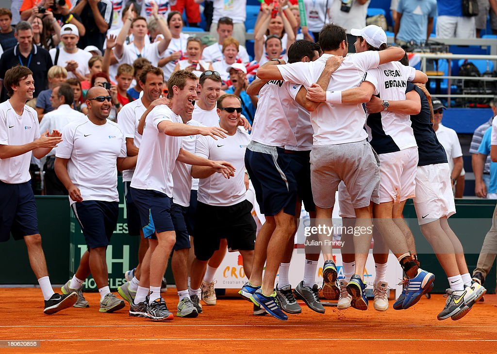 Andy Murray of Great Britain is congratulated by team mates after winning against Ivan Dodig of Croatia during day three of the Davis Cup World Group play-off tie between Croatia and Great Britain at Stadion Stella Maris on September 15, 2013 in Umag, Croatia.
