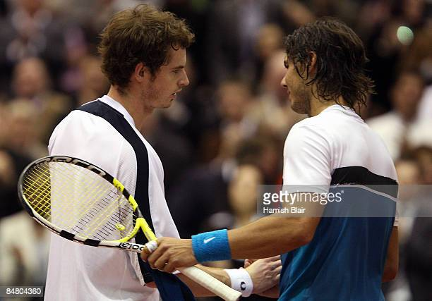 Andy Murray of Great Britain is congratulated on his victory by opponent Rafael Nadal of Spain after the singles final match during day seven of the...