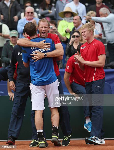 Andy Murray of Great Britain is hugged by team mate Dominic Inglot after his four set victory against Sam Querrey of the United States during day...