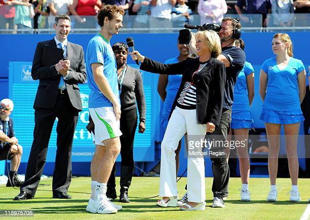 Andy Murray of Great Britain is interviewed by Sue Barker after winning his Men's Singles final against Jo-Wilfried Tsonga of France on day eight of...