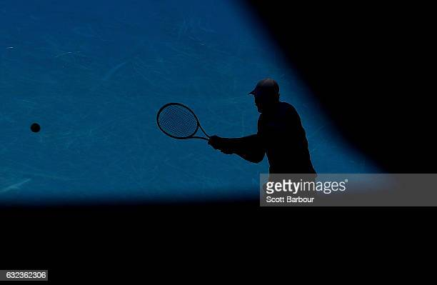 Andy Murray of Great Britain is silhouetted as he plays a backhand in his fourth round match against Mischa Zverev of Germany on day seven of the...